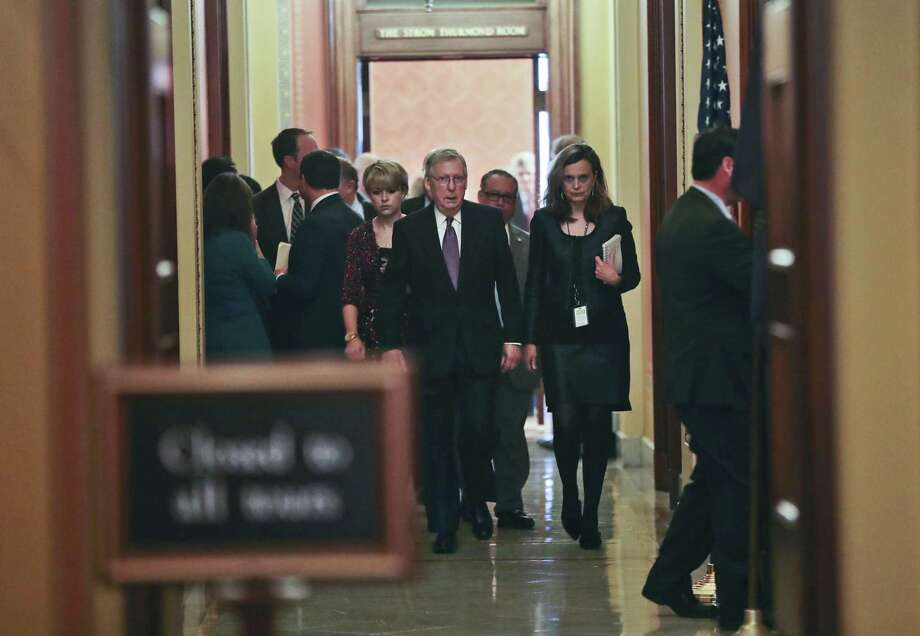 Senate Majority Leader Mitch McConnell of Ky., center, walks with members of his staff following the conclusion of a close-door meeting with fellow GOP Senators, Monday. Yes, they reached a deal to reopen the government, but the fact is the shutdown happened and shouldn't have. Photo: Pablo Martinez Monsivais /Associated Press / Copyright 2018 The Associated Press. All rights reserved.