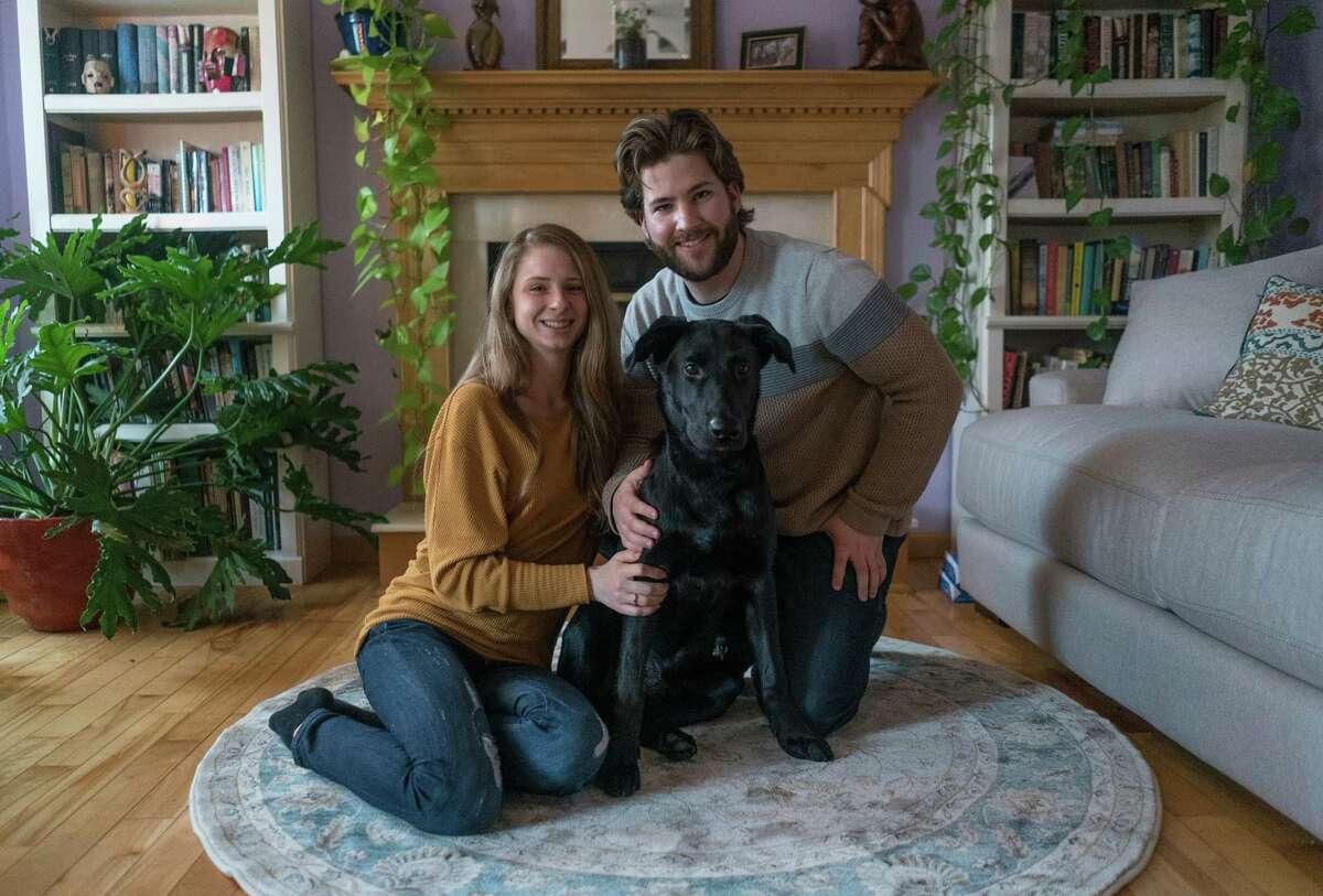 Loki, center, with his owner Garrett Kipp, right, and Garrett's girlfriend Emily. (Provided)