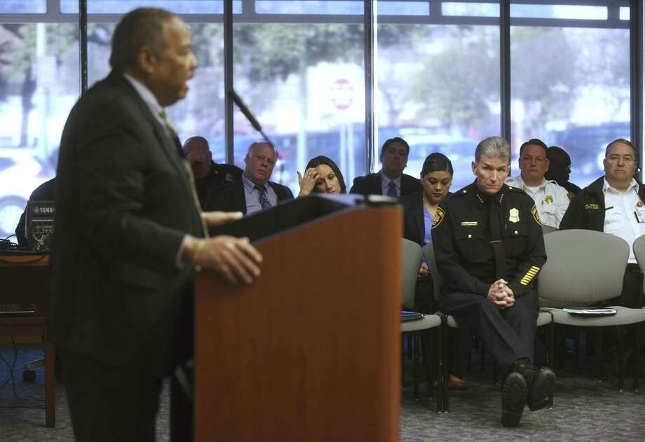 San Antonio Police Chief William McManus (right) listens as Robert Stewart of Bobcat Training and Consulting speaks to the City Council's public safety subcommittee Tuesday. Earlier in the meeting, McManus unveiled a handful of changes aimed at improving procedures within the department's investigative units. Photo: Billy Calzada /San Antonio Express-News / San Antonio Express-News