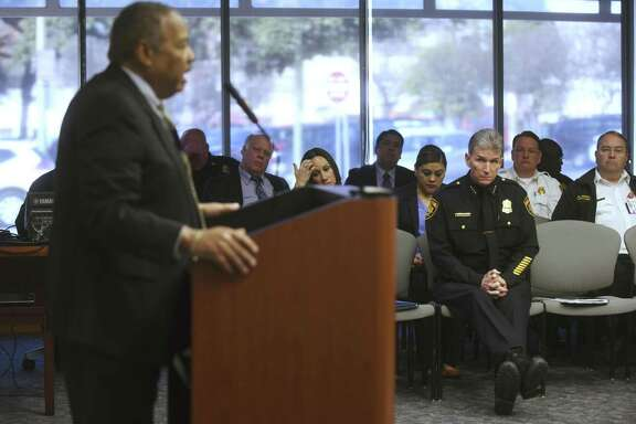 San Antonio Police Chief William McManus (right) listens as Robert Stewart of Bobcat Training and Consulting speaks to the City Council's public safety subcommittee Tuesday. Earlier in the meeting, McManus unveiled a handful of changes aimed at improving procedures within the department's investigative units.