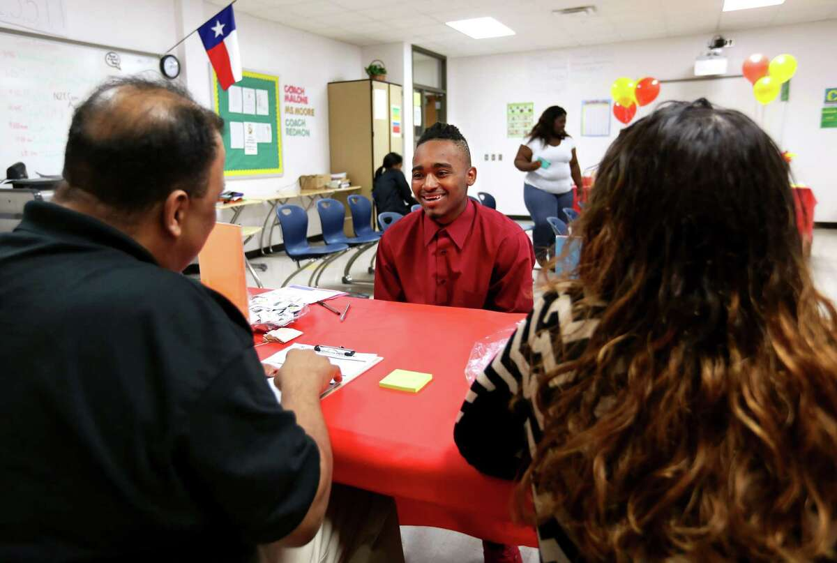 This high school student smiles during an interview during a Hire Houston Youth job fair at Worthing High School last spring, but for many prospective employees, job interviews can elicit more frowns than smiles.
