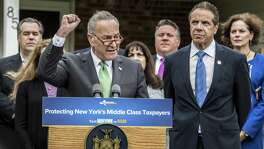 Senator Charles Schumer, left and New York Gov. Andrew Cuomo joined forces Oct. 23 to oppose the tax bill, later approved by Congress. Democrats are harming their political fortunes by insisting something that wasn't apocalyptic is.