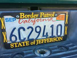 This State of Jefferson Border Patrol license plate frame was on a Toyota pickup parked at the fairgrounds.