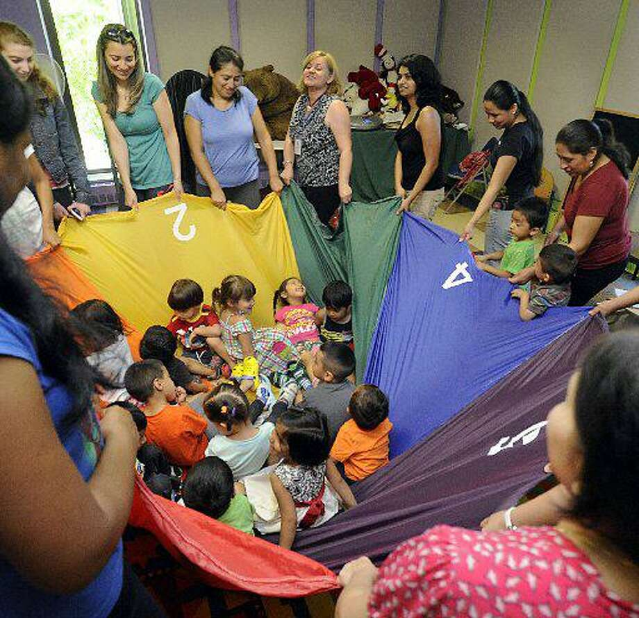 In this file photo Angelina Stojakovic, parent educator at the Danbury Learning Center, center standing, during a weekly class offered by the United Way of Western Connecticut to teach parents near the largely-Latino neighborhood around the Park Avenue Elementary School how to be the primary educators of their children. Photo: / Carol Kaliff