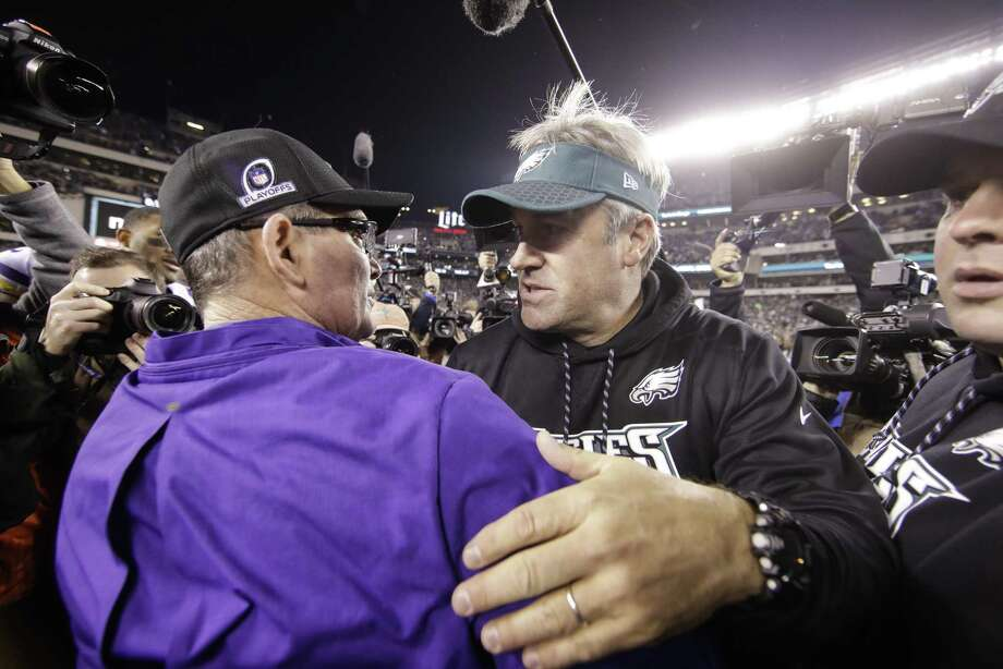 Philadelphia Eagles head coach Doug Pederson talks to Minnesota Vikings head coach Mike Zimmer after the NFL football NFC championship game Sunday, Jan. 21, 2018, in Philadelphia. The Eagles won 38-7 to advance to Super Bowl LII. (AP Photo/Matt Rourke) Photo: Matt Rourke, STF / Associated Press / Copyright 2018 The Associated Press. All rights reserved.