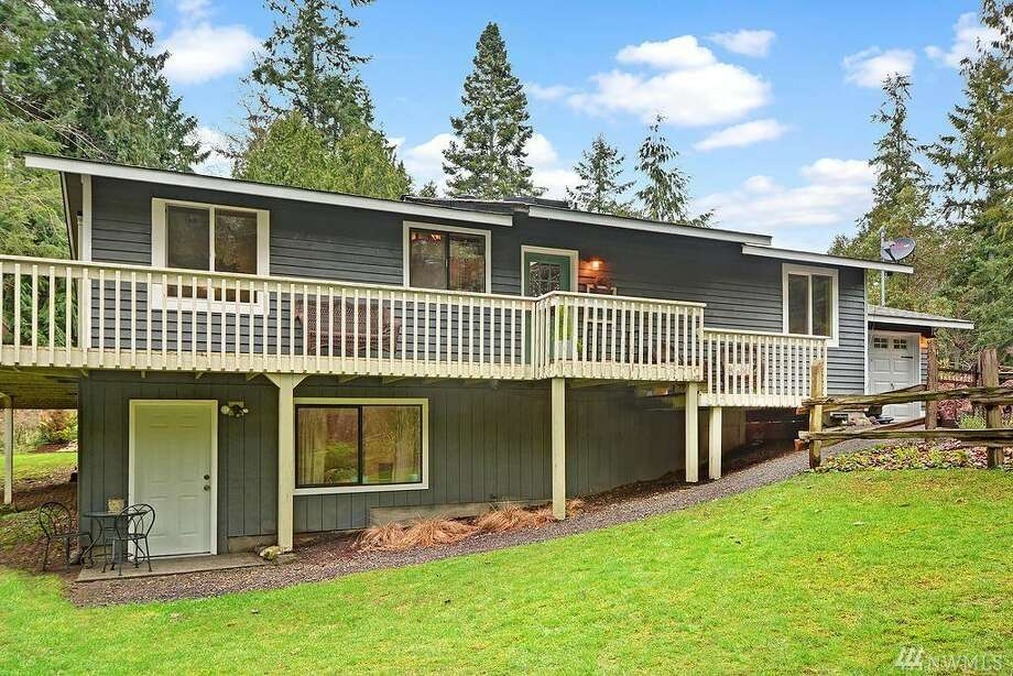This move-in ready abode in the Shore Woods Community boasts 1,788 square feet of floor plan and rustic-chic accents. A master on the main floor has an en suite bath and a picturesque view of the landscape from large windows throughout.The address is 5959 N.E. Spruce Dr. in Hansville, listed for $325,000. See the full listing below. Photo: Aimee Chase - Vista Estate Imaging