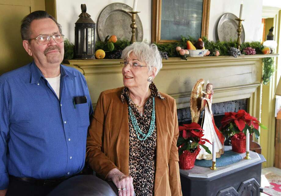 Stanley and Fern Lee at the Queen Anne style mantle in their parlor, once the tavern in the historic Josias Swart House Wednesday Dec. 20, 2017 in Glenville, NY.  (John Carl D'Annibale / Times Union) Photo: John Carl D'Annibale / 20042428A
