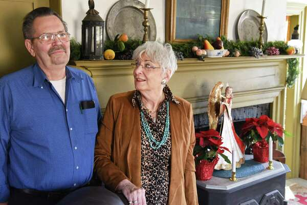 Stanley and Fern Lee at the Queen Anne style mantle in their parlor, once the tavern in the historic Josias Swart House Wednesday Dec. 20, 2017 in Glenville, NY.  (John Carl D'Annibale / Times Union)