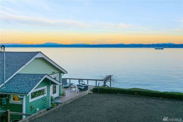 Take in spectacular views of Rainier, Seattle and the shipping lane with this quintessential cabin at the beach. Lovingly remodeled, the home is freshly painted and offers new flooring, an updated bath and new roof. The property also features 115' of bulk-headed waterfront, minutes to towns and ferries.  27124 Washington Blvd. N.E., listed for $575,000. See the full listing below.
