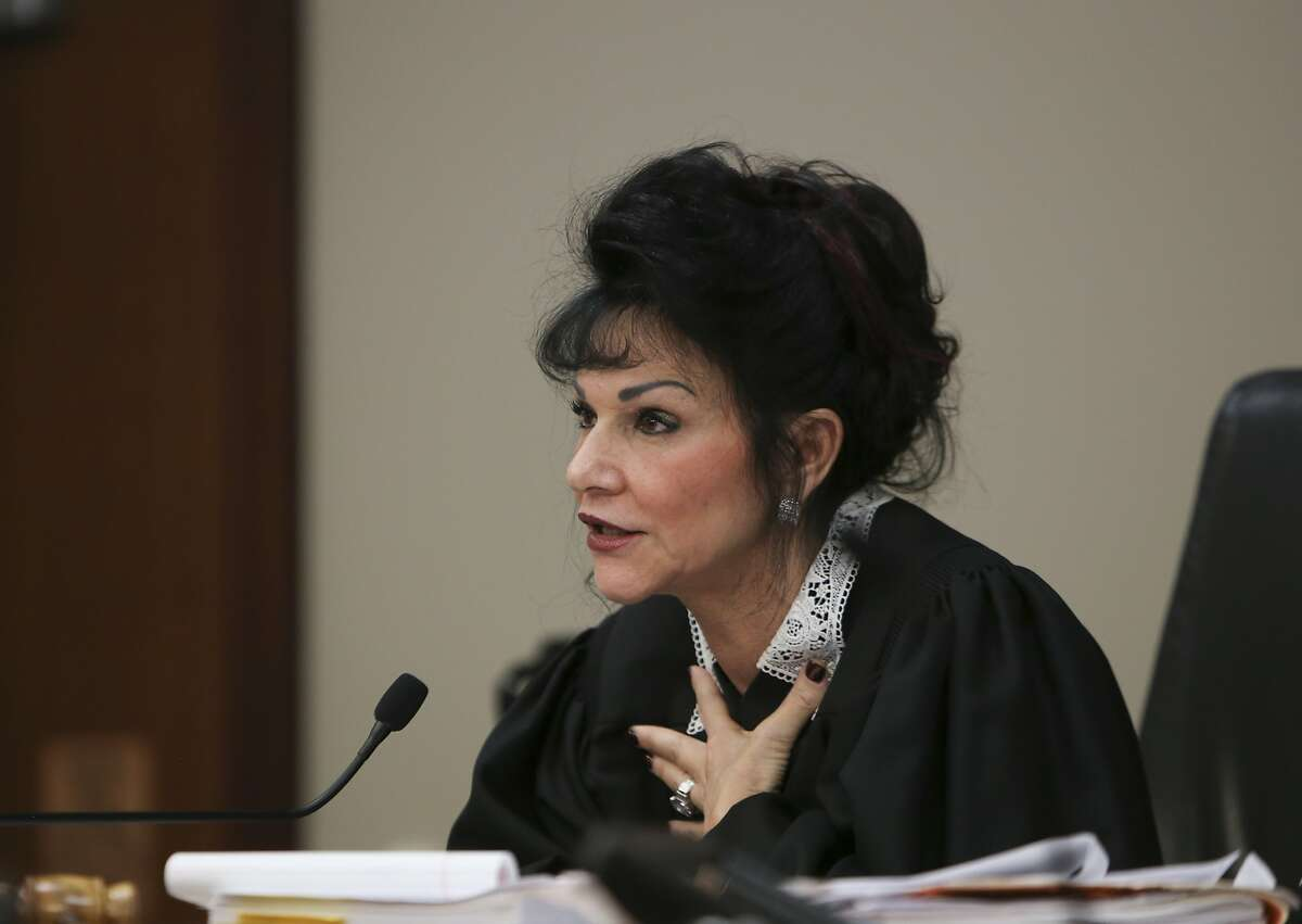 Judge Rosemarie Aquilina addresses a woman after her victim impact statement Tuesday, Jan. 16, 2018, during the first day of the sentencing hearing for former sports medicine doctor Larry Nassar, in Lansing, Mich. Nassar pleaded guilty to molesting females with his hands at his Michigan State University office, his home and a Lansing-area gymnastics club. (Matthew Dae Smith/Lansing State Journal via AP)