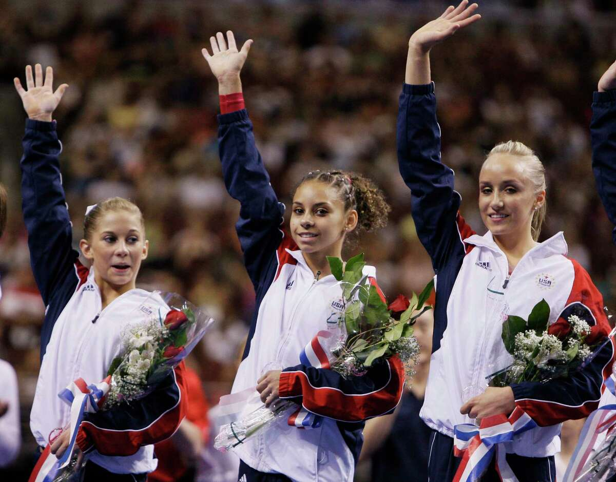 From left, Shawn Johnson, Mattie Larson and Nastia Liukin wave to spectators following the women's second day of competition at the U.S. Olympic gymnastics trials, Sunday, June 22, 2008, in Philadelphia. Johnson and Liukin were nominated to the U.S. Olympic team after the event. (AP Photo/Julie Jacobson)