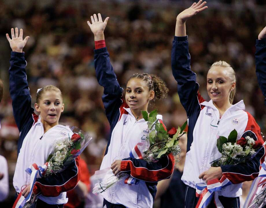 From left, Shawn Johnson, Mattie Larson and Nastia Liukin wave to spectators following the women's second day of competition at the U.S. Olympic gymnastics trials, Sunday, June 22, 2008, in Philadelphia. Johnson and Liukin were nominated to the U.S. Olympic team after the event. (AP Photo/Julie Jacobson) Photo: Julie Jacobson, STF / AP