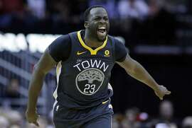 Golden State Warriors forward Draymond Green (23) reacts after scoring against the Houston Rockets during the second half of an NBA basketball game Saturday, Jan. 20, 2018, in Houston. (AP Photo/Michael Wyke)
