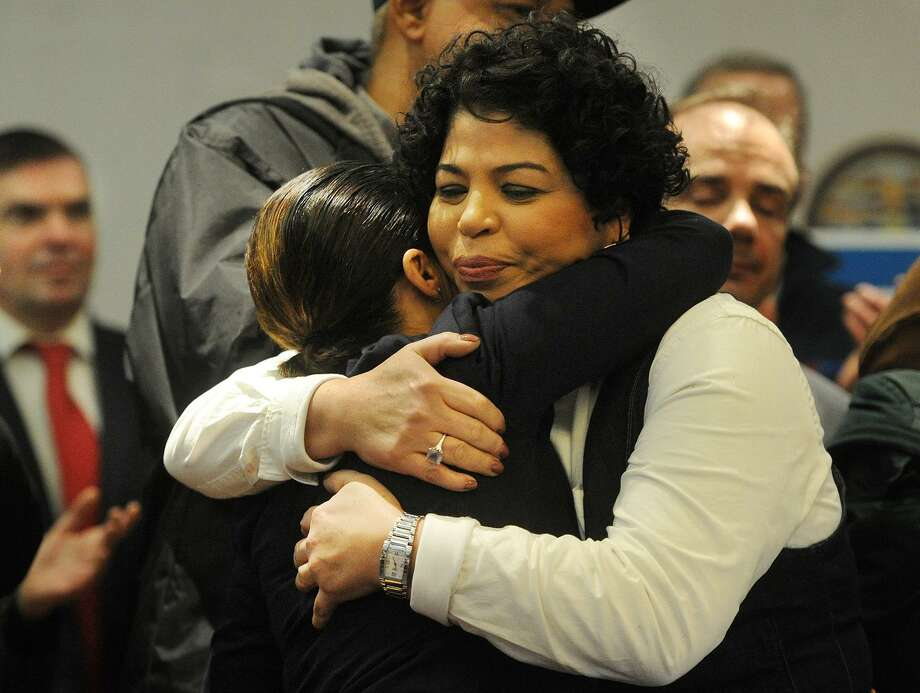 Connecticut Community for Addiction Recovery Volunteer Coordinator Liz Torres, right, hugs Bridgeport Health and Social Services Director Maritza Bond at the announcement of a new opiod awareness campaign, BPT I am U, at the Margaret Morton Government Center in Bridgeport, Conn. on Tuesday, January 23, 2018. Photo: Brian A. Pounds / Hearst Connecticut Media / Connecticut Post