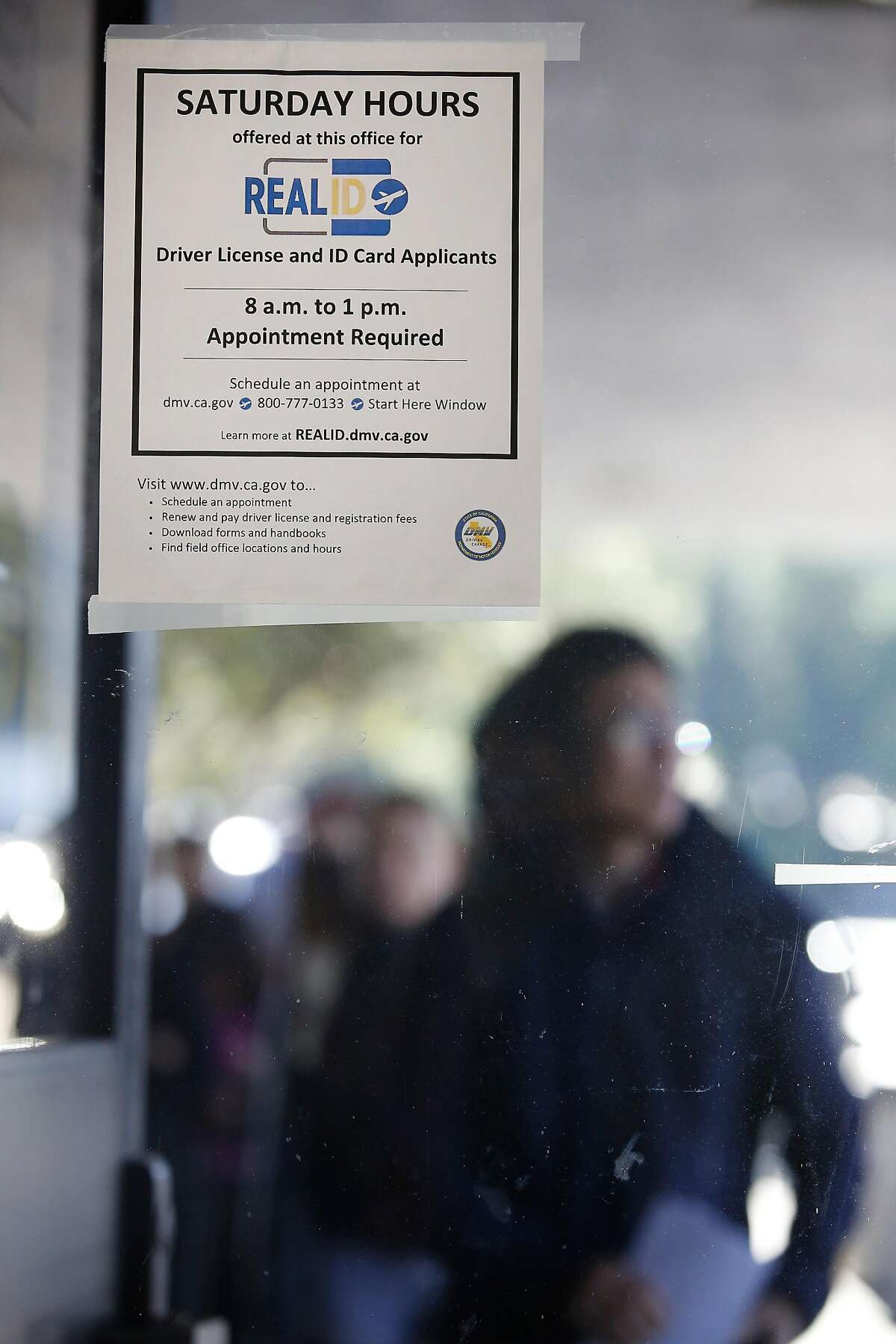 A sign for Saturday hours for Real ID applicants is seen at the Department of Motor Vehciles on Tuesday, January 23, 2018 in Daly City, Calif.