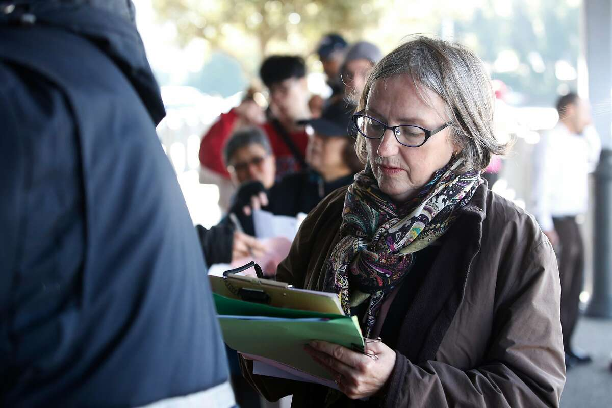 Barbara Wittrock of San Francisco fills out a form as she stands in line to apply for the Real ID at the Department of Motor Vehciles on Tuesday, January 23, 2018 in Daly City, Calif.