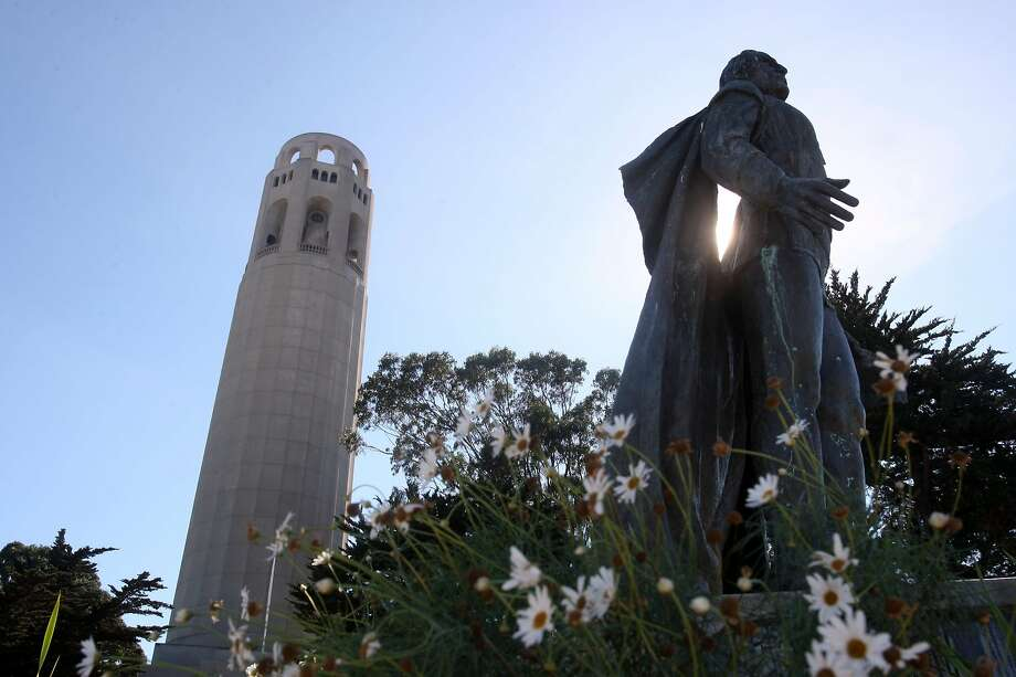 Coit Tower in San Francisco, Calif., is marking its 75th Anniversary on this Saturday.  A view of the tower from the parking lot with the statue of Christopher Columbus in the foreground on Tuesday, October 20, 2008. Photo: Liz Hafalia / The Chronicle 2008