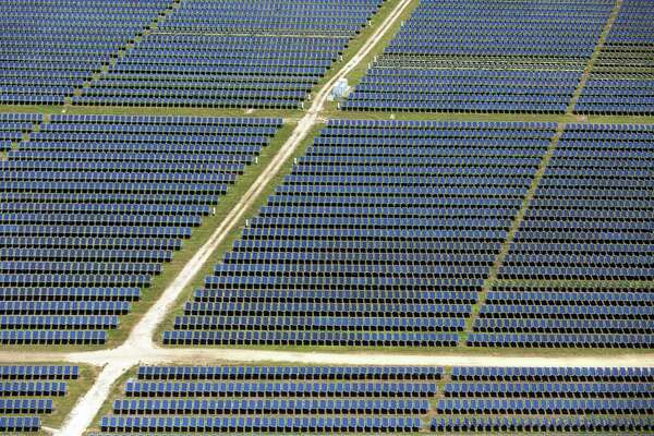 Rows of solar panels make up part of the Alamo 1 solar plant on San Antonio's south side. Solar installations in Texas fell slightly in 2017 compared to 2016.