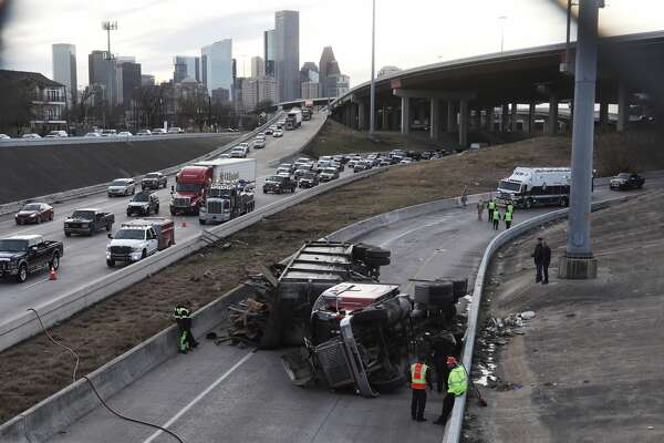 Police investigate an 18-wheeler crash on the entrance ramp to IH-10, near downtown, Tue. Jan. 23, 2018 in Houston.