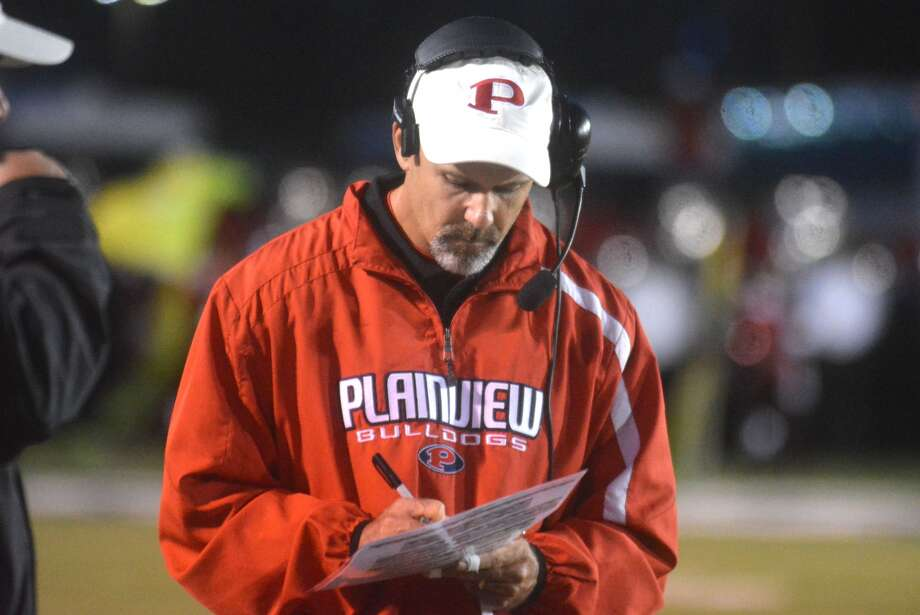 Plainview defensive coordinator Lee Walker checks his notes during a football game last season. Walker will leave Plainview to take the head football coaching job at Muleshoe. He'll also be the athletic director there. It is Walker's first chance to be a head coach in 27 years of coaching. Photo: Skip Leon/Plainview Herald