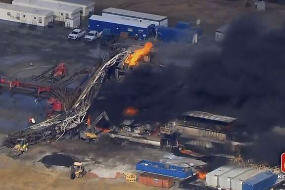 In this photo provided from a frame grab from Tulsa's KOTV/NewsOn6.com, fires burn at an eastern Oklahoma drilling rig near Quinton, Okla., Monday Jan. 22, 2018. The bodies of five workers, including one Texan, were found Tuesday.