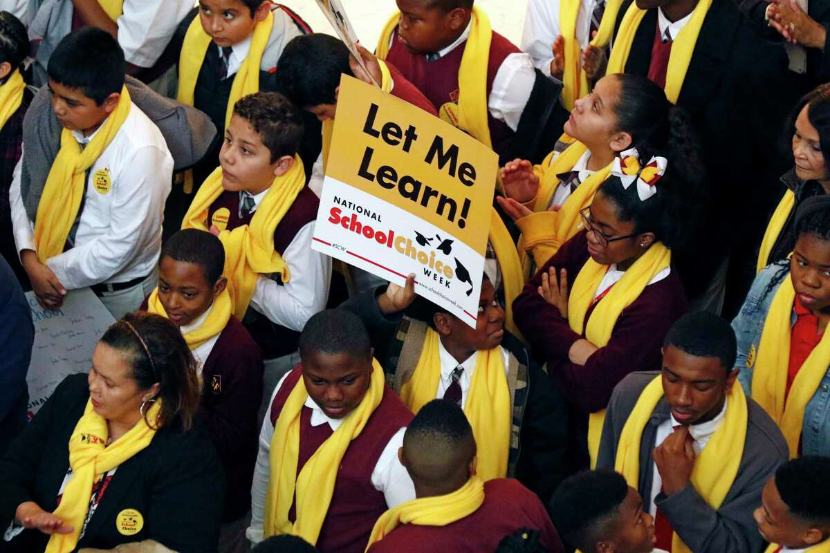 Students from charter, private, parochial and home schools, participate in a school choice proponents rally Tuesday, Jan. 23, 2018, at the Capitol in Jackson, Miss., as prospects remain unclear for House and Senate bills that would expand programs to spend public money to pay for students to attend private schools. (AP Photo/Rogelio V. Solis)