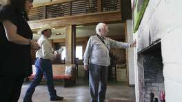 William A. Storrer, expert on Frank Loyd Wright architecture, checks the finish of a block wall as he  visits the Flying L Guest Ranch to inspect the pilot's lounge and guest villas  on April 6, 2017.
