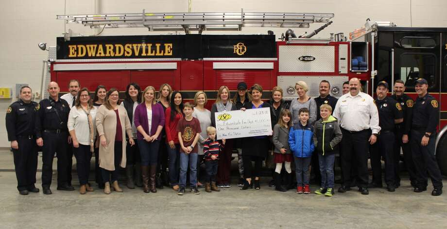 The Edwardsville/Glen Carbon Junior Service Club made a donation Tuesday night to the Edwardsville Fire Department. Photo: Cody King • Cking@edwpub.net