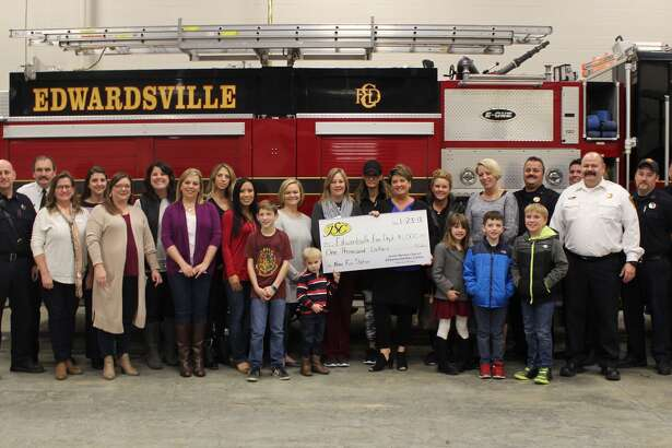 The Edwardsville/Glen Carbon Junior Service Club made a donation Tuesday night to the Edwardsville Fire Department.