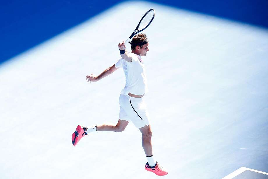 MELBOURNE, AUSTRALIA - JANUARY 22:  Roger Federer of Switzerland plays a backhand in his fourth round match against Marton Fucsovics of Hungary on day eight of the 2018 Australian Open at Melbourne Park on January 22, 2018 in Melbourne, Australia.  (Photo by Darrian Traynor/Getty Images) Photo: Darrian Traynor, Getty Images
