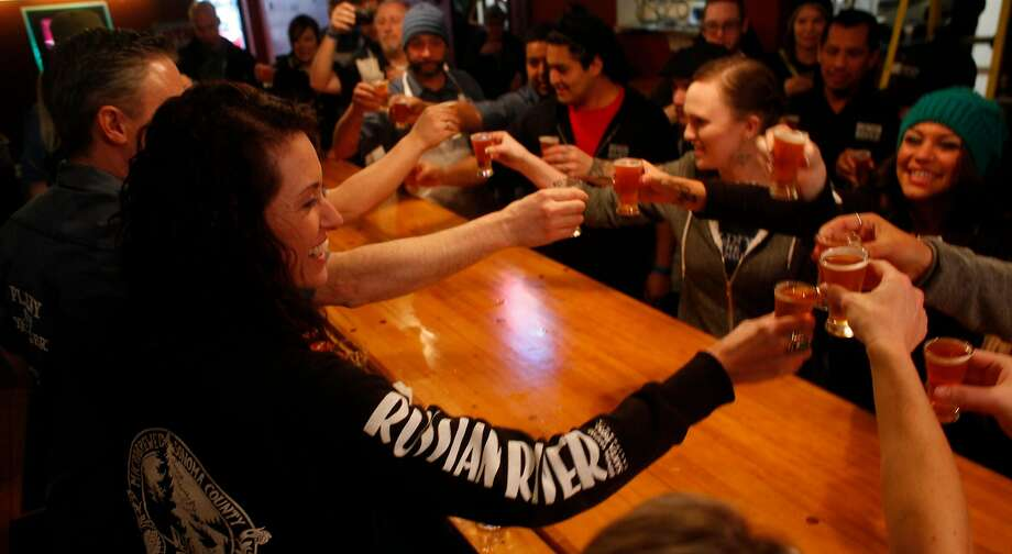 Natalie Cilurzo co-owner of the Russian River Brewing Company toasts her staff with a taste of the much-anticipated Pliny the Younger Ale, before opening the doors to a waiting crowd,  Friday February 7, 2014,  in Santa Rosa, Calif. Photo: Lacy Atkins, The Chronicle