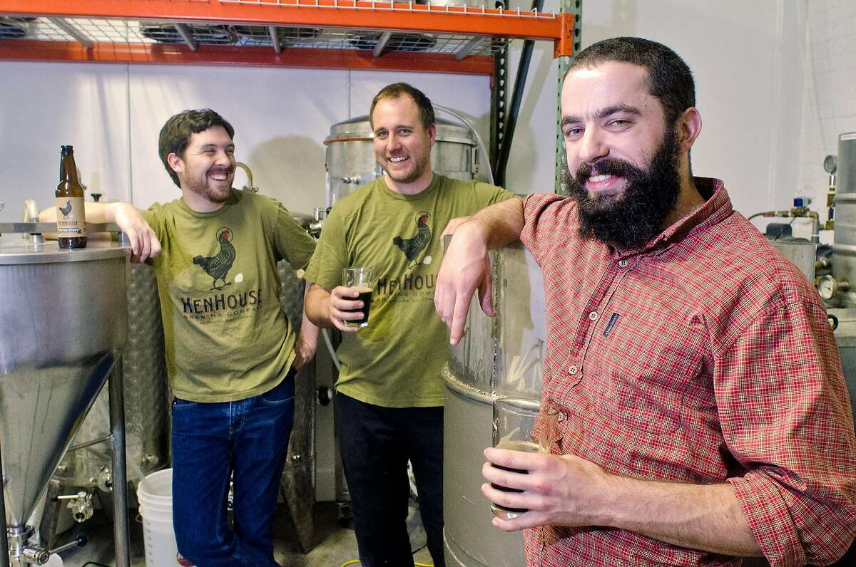 The HenHouse Brewing Company team, Shane Goepel (left), Scott Goyne and Collin McDonnell enjoy a brew of their Oyster Stout in Petaluma, California on August 31, 2012.