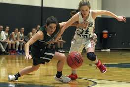 Sacred Heart's Leah Atkins, left, and GFA's Katherine Marcus scramble for a loose ball Tuesday.