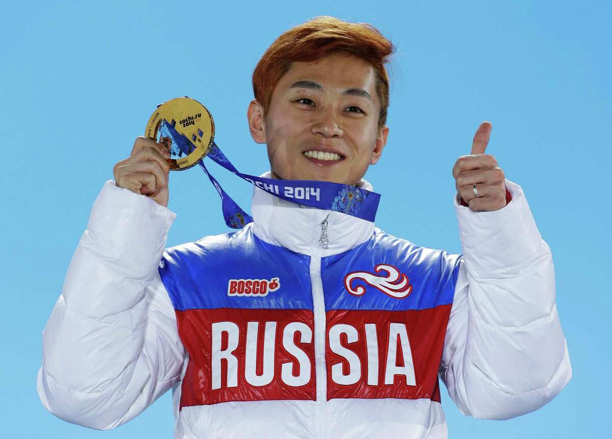 FILE - In this Feb. 15, 2014, file photo, men's 1,000-meter short track speedskating gold medalist Viktor Ahn, of Russia, gestures while holding his medal during the medals ceremony at the Winter Olympics in Sochi, Russia. The Russian Olympic Committee says Ahn, a six-time Olympic gold medalist, is among several top Russian athletes barred from the upcoming Pyeongchang Olympics amid the country?'s ongoing doping scandal. (AP Photo/David J. Phillip, File)