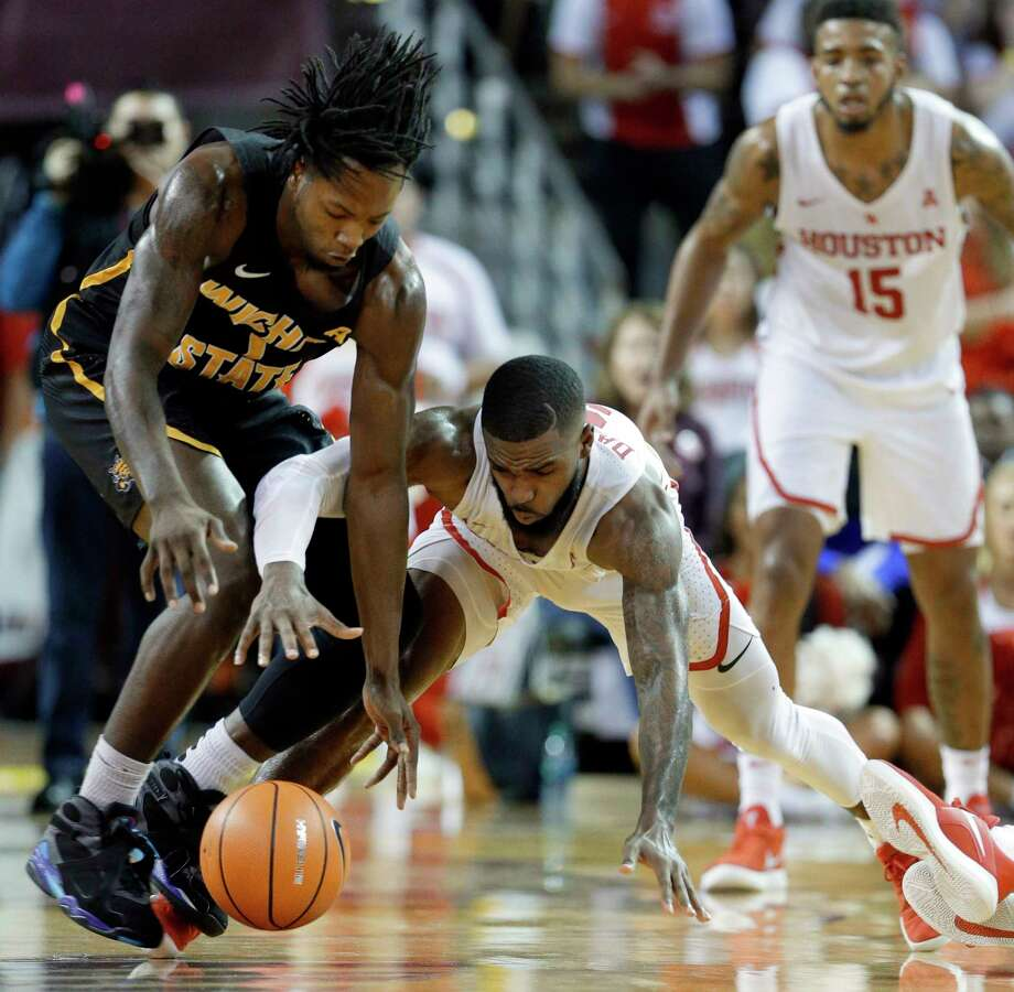 Wichita State forward Zach Brown (1) and Houston guard Corey Davis Jr. (5) battle for a loose ball during the second half of their game at H&PE Arena at Texas State University Saturday, Jan. 20, 2018, in Houston, TX. (Michael Wyke / For the  Chronicle) Photo: Michael Wyke, Freelance / © 2017 Houston Chronicle
