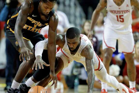 Wichita State forward Zach Brown (1) and Houston guard Corey Davis Jr. (5) battle for a loose ball during the second half of their game at H&PE Arena at Texas State University Saturday, Jan. 20, 2018, in Houston, TX. (Michael Wyke / For the  Chronicle)