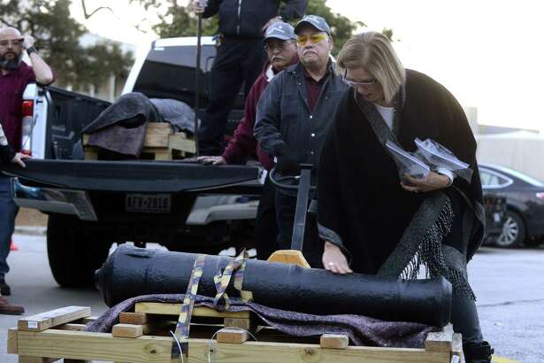 Alamo conservator Pam Rosser examines the Spanish cannon, one of two historic cannons used in the 1836 Battle of the Alamo, upon its return Tuesday from the Texas A&M Conservation Research Lab in College Station.