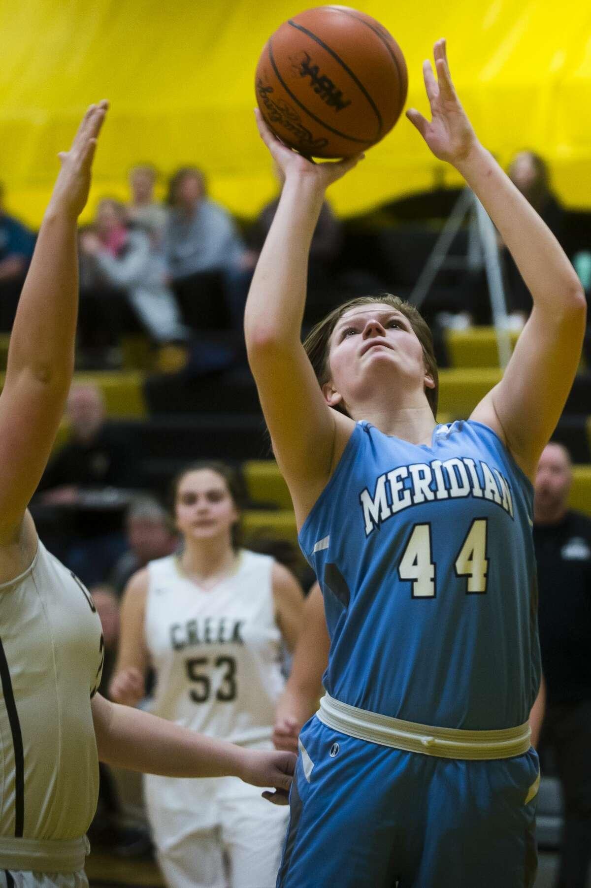 Meridian junior Baleigh Hill takes a shot during a game against Bullock Creek on Tuesday, Jan. 23, 2018 at Bullock Creek High School. Bullock Creek won 42-33. (Katy Kildee/kkildee@mdn.net)
