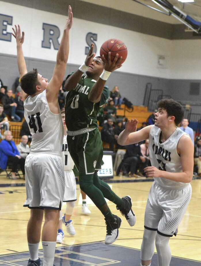 Norwalk's #0 Tyrique Langley shoots and scores vs. Staples High School in boys basketball action in Westport Conn, on Tuesday january 23, 2018 Photo: Alex Von Kleydorff / Hearst Connecticut Media / Norwalk Hour