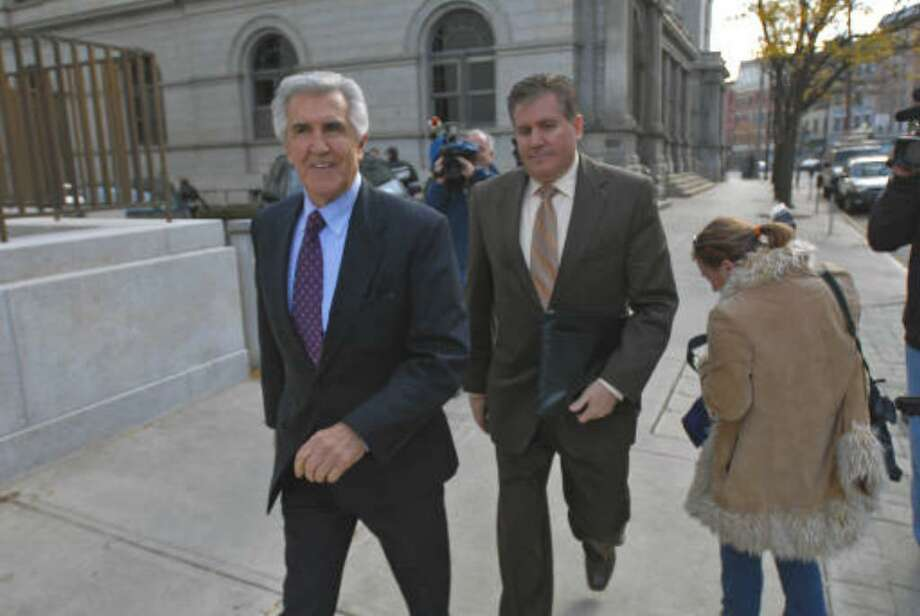 Former Senate Majority Leader Joseph Bruno, left,  arrives at the federal courthouse in Albany with his son Kenneth for his 2009 trial. (Phillip Kamrass / Times Union)