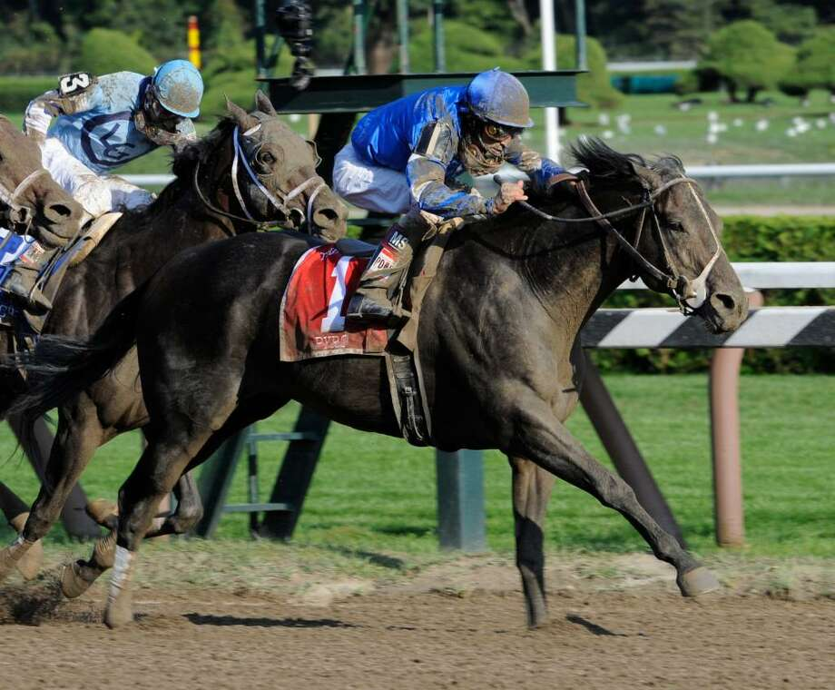 Pyro, ridden by jockey John Velazquez, wins the 30th running of the Forego at Saratoga Race Course.   (Skip Dickstein / Times Union) Photo: SKIP DICKSTEIN