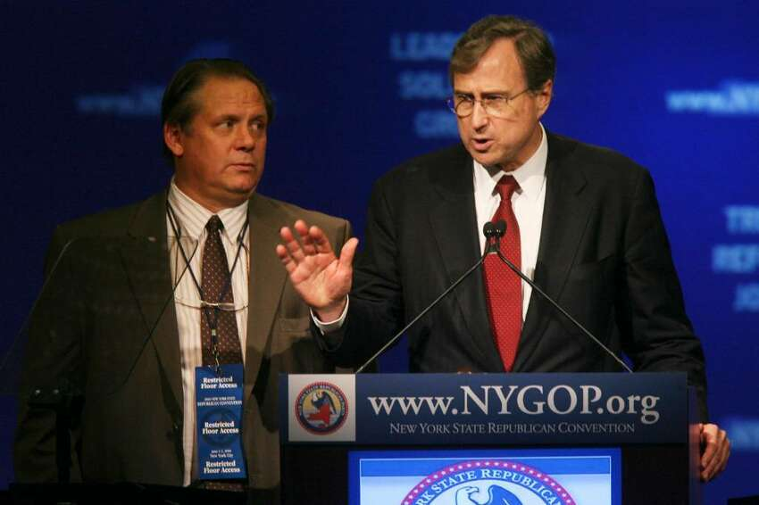 Longtime Republican stalwart Ed Cox says he can work as state party chairman to elect Rick Lazio governor despite his backing of Steve Levy. Jeff Buley is at left. (Mary Altaffer/Associated Press