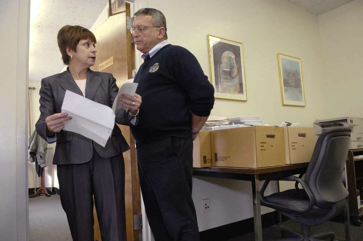 Paula Mahan, left, re-elected Colonie town supervisor Tuesday, talks with Town Attorney Michael Magguilli, right, as they go over an agreement with a local school district at Colonie Town Hall on Wednesay, Nov. 4, 2009. (Paul Buckowski / Times Union)