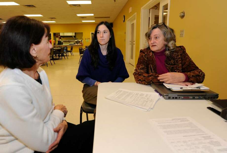 Discussing Medicare options at the Watervliet Senior Center in Watervliet on Dec. 22, 2009, are MaryAnn Holoboski, left, Michelle Cinque, center, a grad student at the University at Albany, and Peggy Moran, of the Albany County Health Insurance Information, Counseling and Assistance Program.  (Skip Dickstein / Times Union) Photo: Skip Dickstein / 2008