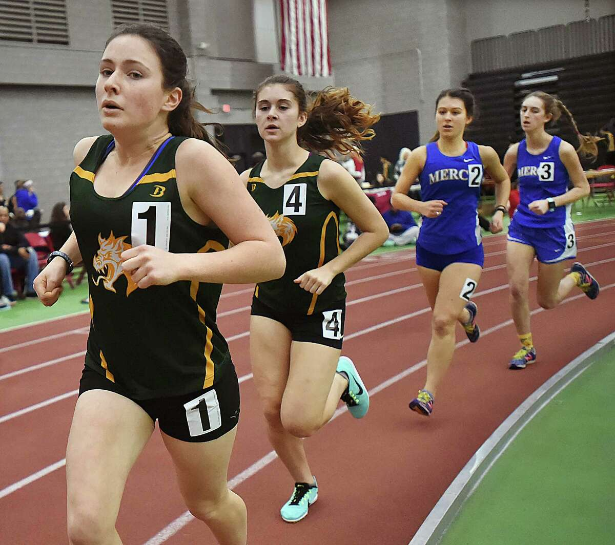 Hamden sophomore Ella Bradford, wearing #1, won the 1600 meter run in 5:45.61 at the SCC West Sectional indoor track and field meet, Tuesday, Jan. 23, 2018, at Floyd Little Athletic Center in Ne5:54.60. Placing second in 5:25.85, Hamden senior Jackie Theroux wearing #4, finishishing in third in 5:49.67 is Mercy junior Mae Grochowski wearing #2 and fourth place finisher is Mercy senior Maeve Williams running a 5:59.24. Hamden girls won the meet.
