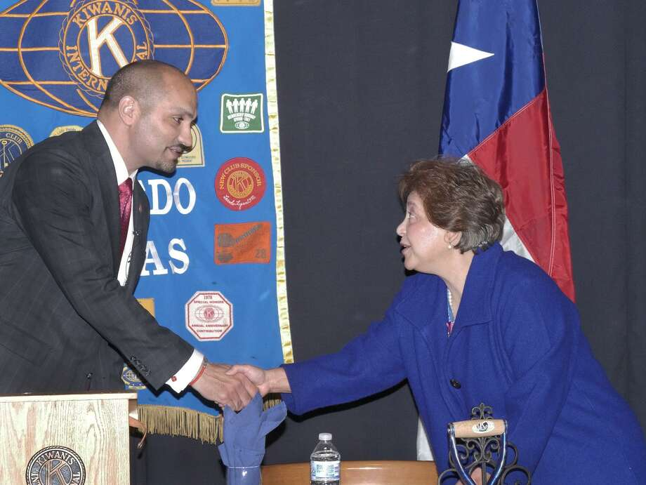 Webb County Judge Tano Tijerina and former Webb County Tax Assessor-Collector Patricia Barrera, who is challenging him for his post in the upcoming primary, shake hands before participating in a political forum at the Kiwanis Club meeting on Tuesday at the Ramada Plaza. Photo: Cuate Santos /Laredo Morning Times / Laredo Morning Times