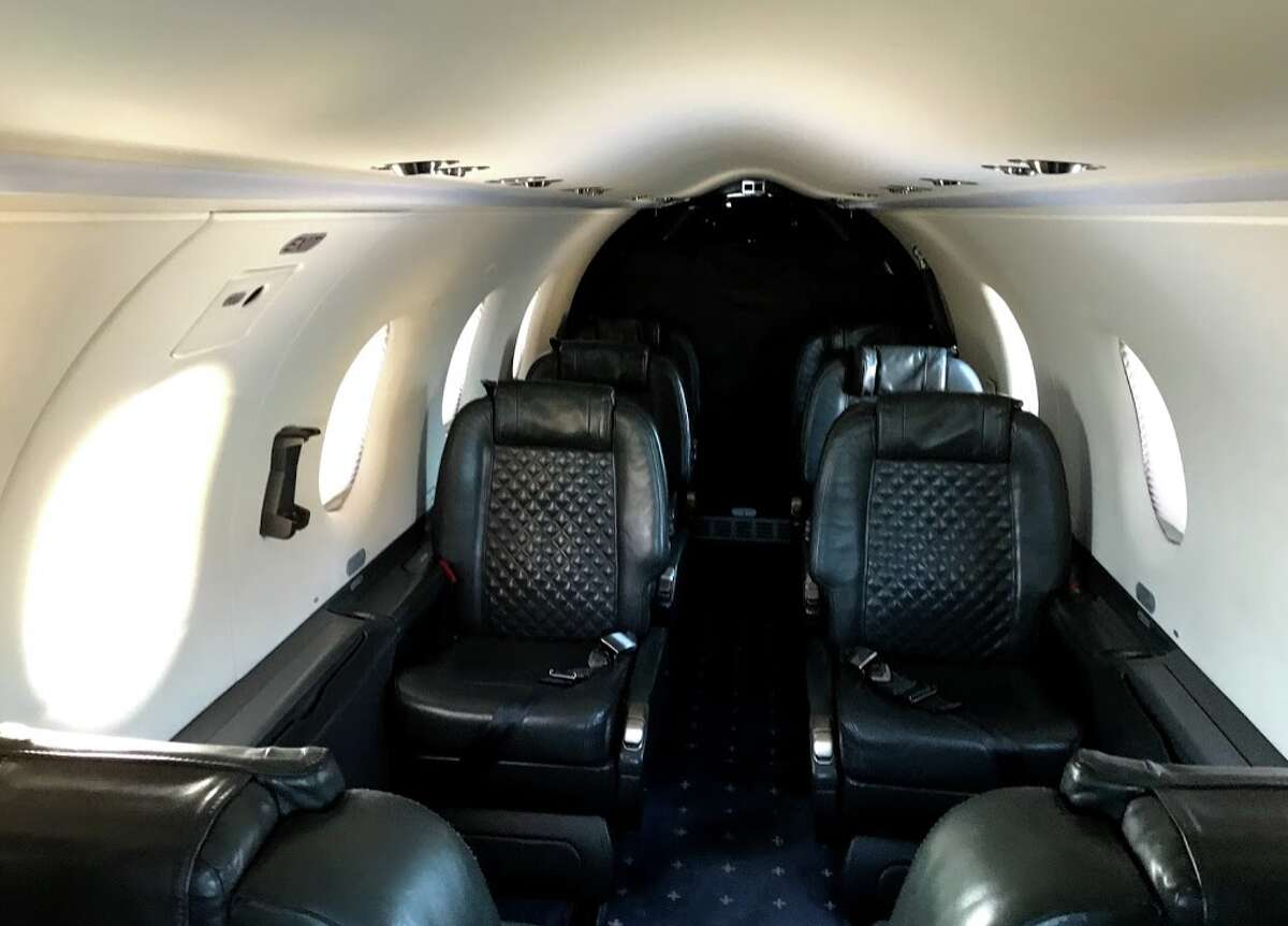 Onboard Surf Air's Pilatus PC-12 there are four seats that face each other, and then four more in the rear that face forward.