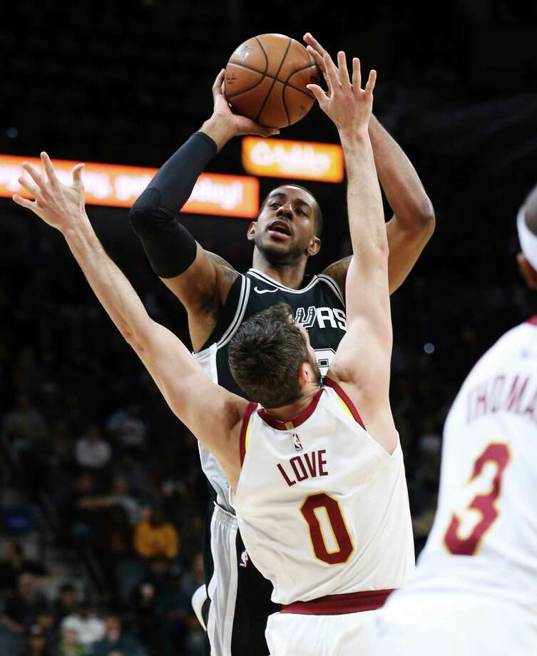 Spurs' LaMarcus Aldridge (12) shoots against Cleveland Cavaliers' Kevin Love (00) at the AT&T Center on Tuesday, Jan. 23, 2018. Photo: Kin Man Hui, San Antonio Express-News / ©2018 San Antonio Express-News
