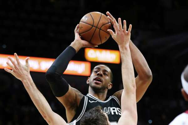 Spurs' LaMarcus Aldridge (12) shoots against Cleveland Cavaliers' Kevin Love (00) at the AT&T Center on Tuesday, Jan. 23, 2018.
