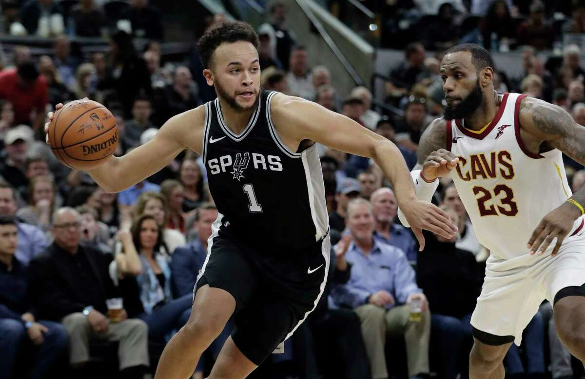 San Antonio Spurs forward Kyle Anderson (1) drives around Cleveland Cavaliers forward LeBron James (23) during the second half of an NBA basketball game, Tuesday, Jan. 23, 2018, in San Antonio. San Antonio won 114-102. (AP Photo/Eric Gay)